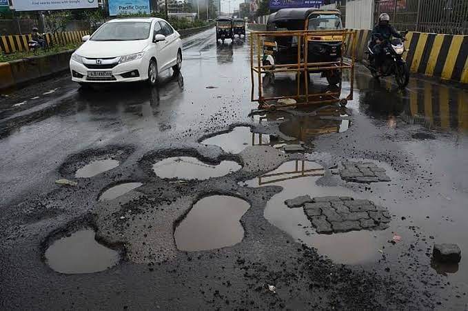 A road filled with potholes in Bhopal.
