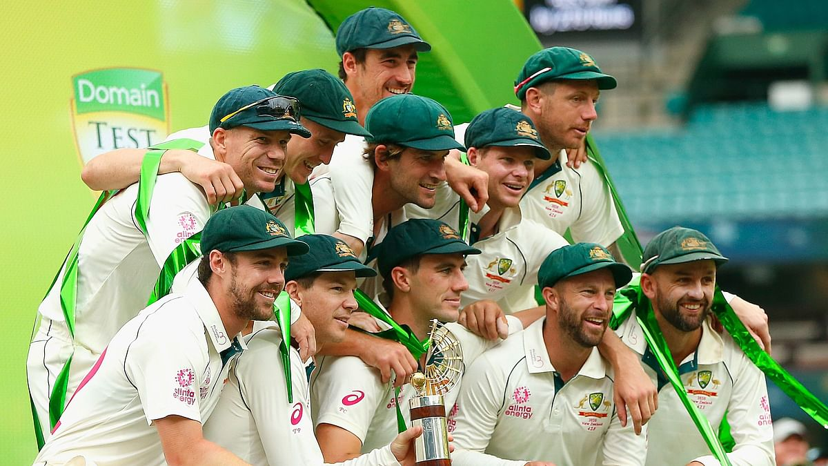The Australian team poses with the Trans-Tasman Trophy after winning the series on the fourth day of the third cricket Test match between Australia and New Zealand at the Sydney Cricket Ground in Sydney on January 6, 2020.