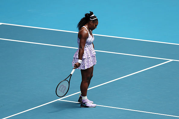 Australia Open: Serena Williams knocked out after stunning defeat to Wang Qiang