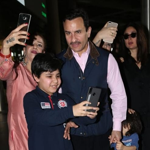Pataudis get mobbed: Saif Ali Khan pulls down a fan's arm, Taimur calls for 'amma' Kareena