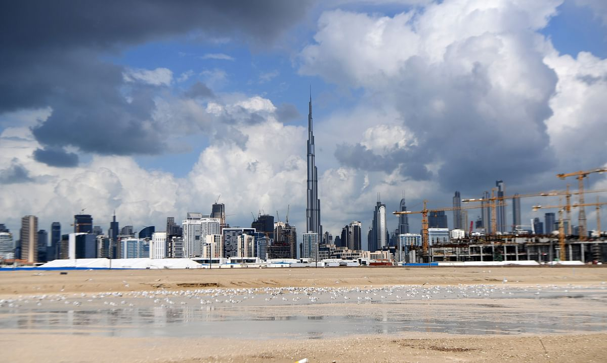 A picture shows dark clouds over the skyline of Dubai with Burj Khalifa, the world's tallest building.