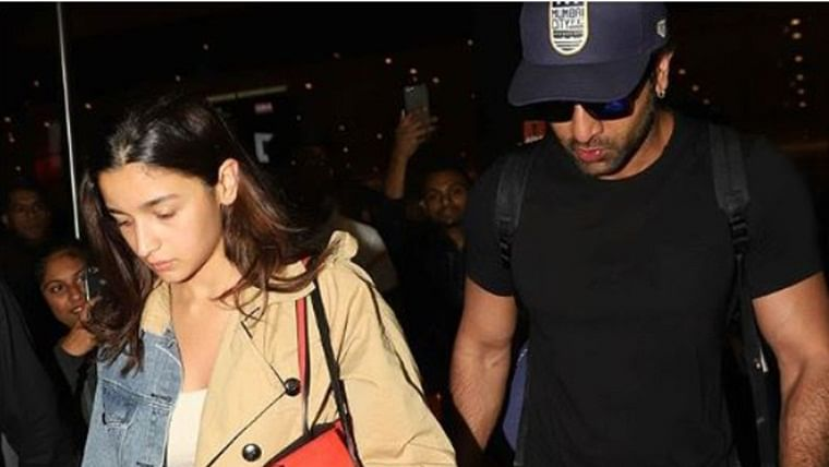 Watch: Ranbir Kapoor safely escorts Alia Bhatt from the fans gathered at the airport