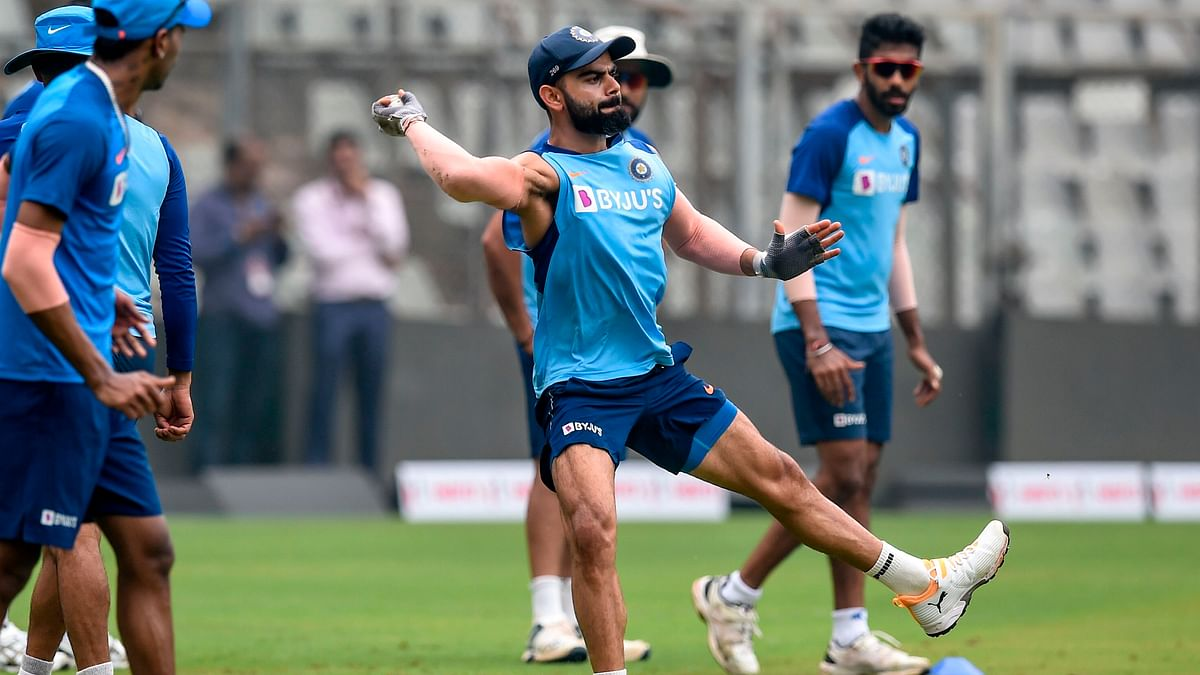 India's Virat Kohli (C) bowls as he attends a training session ahead of the first one day international (ODI) cricket match of a three-match series between Australia and India, at the Wankhede Stadium in Mumbai on January 13, 2020.