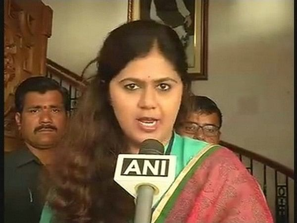 BJP placates sulking  Pankaja Munde; Vinod Tawde rewarded too
