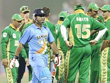 MS Dhoni walks away after being dismissed
