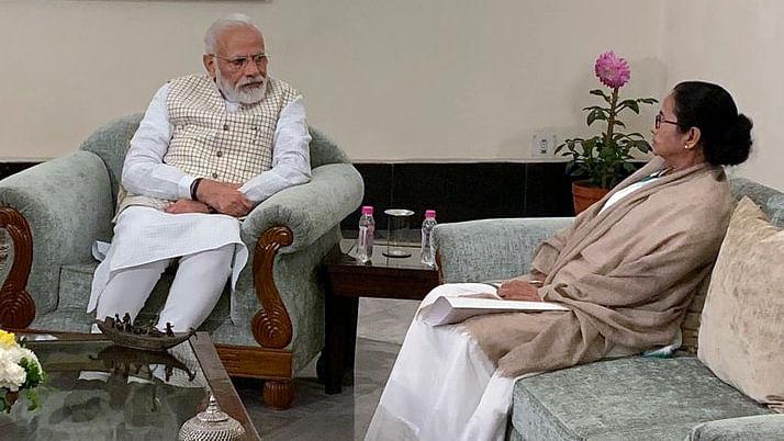 Prime Minister Narendra Modi meets West Bengal Chief Minister Mamata Banerjee at Raj Bhawan in Kolkata on Saturday.