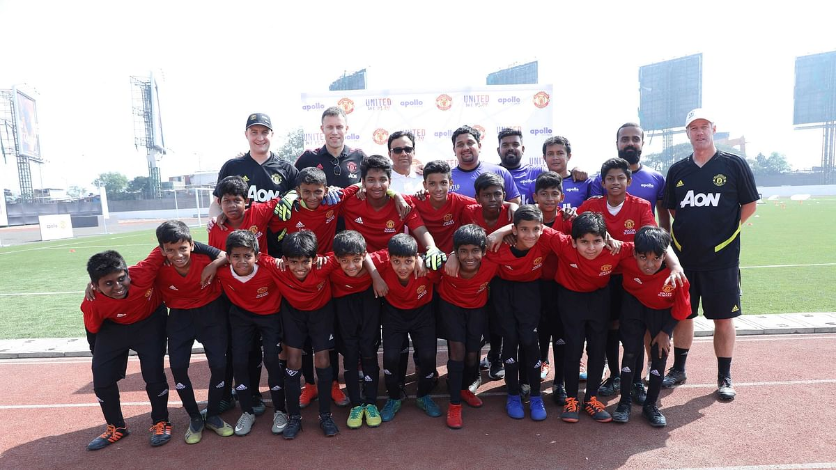 Mike Neary, Head of Manchester United Soccer Schools (1st from left in back row), Ronny Johnsen, Manchester United Legend & Treble Winner (2nd from left in back row), Rajesh Dahiya, Vice President, Marketing, Sales & Service (India, SAARC, Oceania), Apollo Tyres Ltd (3rd from left in back row) with other coaches at the launch of 'United We Play' programme.
