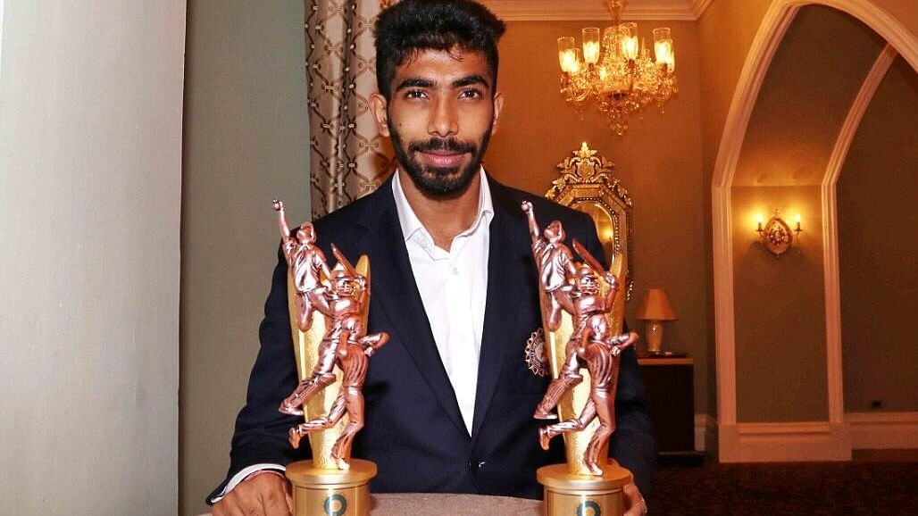 Jasprit Bumrah with his two awards.