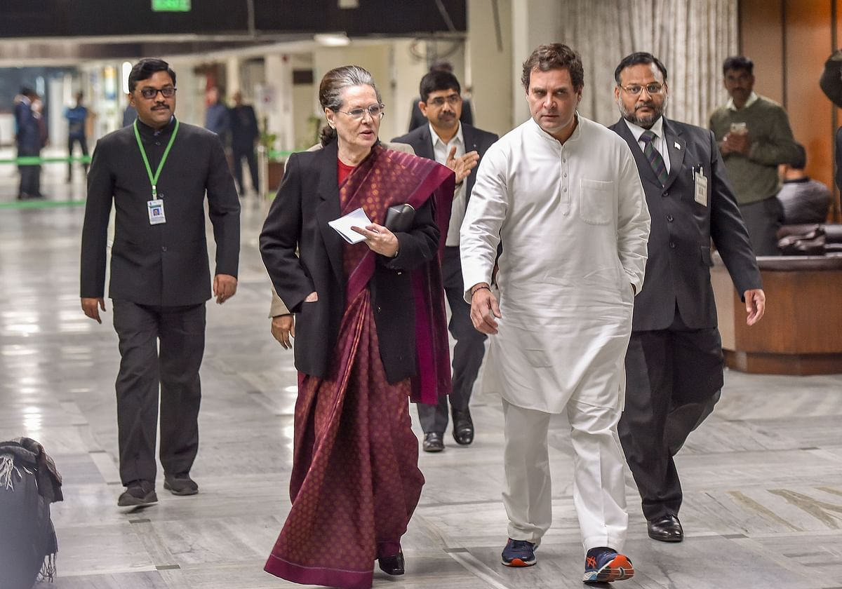 Congress interim President Sonia Gandhi along with party leader Rahul Gandhi arrives for an Opposition leaders' meeting to discuss the current political situation following widespread protests against the amended Citizenship Act and the violence on campuses, in New Delhi, Monday.