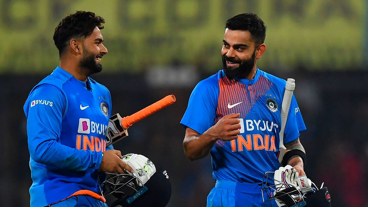 India's cricket team captain Virat Kohli speaks with teamate Rishabh Pant (L) after winning the second T20 international cricket match of a three-match series between India and Sri Lanka at the Holkar Cricket Stadium in Indore on January 7, 2020.