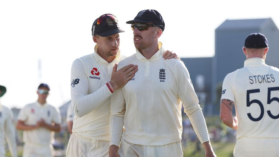 Jack Leach (left) with England skipper Joe Root.
