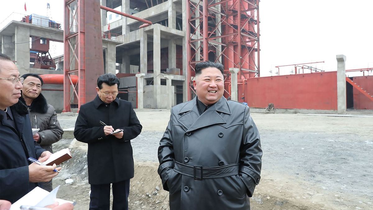 This undated picture released from North Korea's official Korean Central News Agency (KCNA) shows North Korean leader Kim Jong Un (R) visiting the construction site of the Sunchon phosphatic fertiliser factory in South Pyongan province.