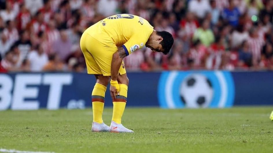 Barcelona's Luis Suarez out for key four months after knee surgery