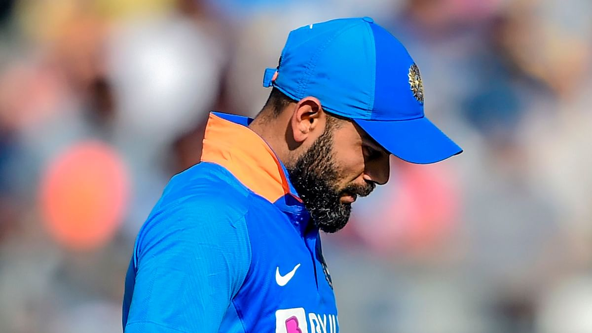 India's Virat Kohli walks back to the pavillion after his dismissal during the first one day international (ODI) cricket match of a three-match series between India and Australia at the Wankhede Stadium in Mumbai on January 14, 2020.