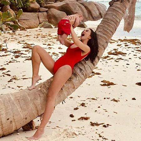 Amy Jackson gives 'Baywatch' vibes in a hot red monokini