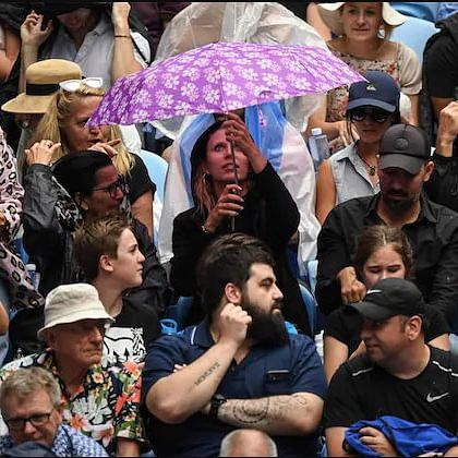 Rain and smog wreak havoc as conditions worsen at Australia Open