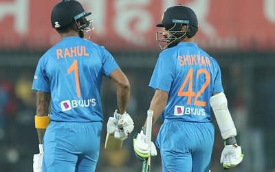 KL Rahul (left) walks with Shikhar Dhawan to open India's innings.