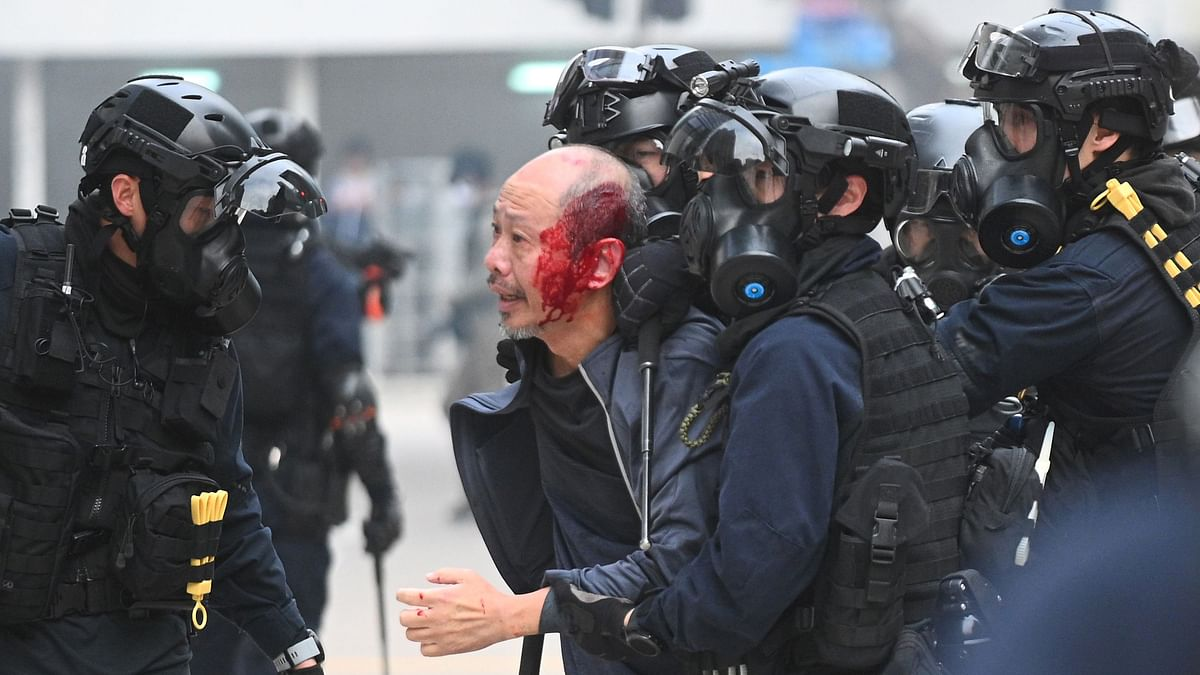 Two officers hurt as HK rally ends in violence