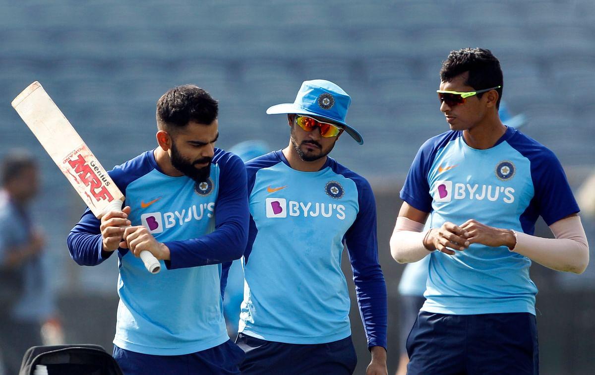 Indian skipper Virat Kohli, Navdeep Saini and Manish Pandey during a practice session ahead of the Third T20 match against Sri Lanka, at Maharashtra Cricket Association Stadium in Pune on Thursday.