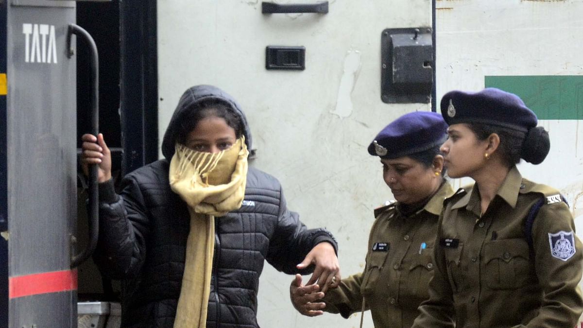 Honey-trap accused Arti Dayal being brought by income-tax officials to Bhopal on Tuesday.