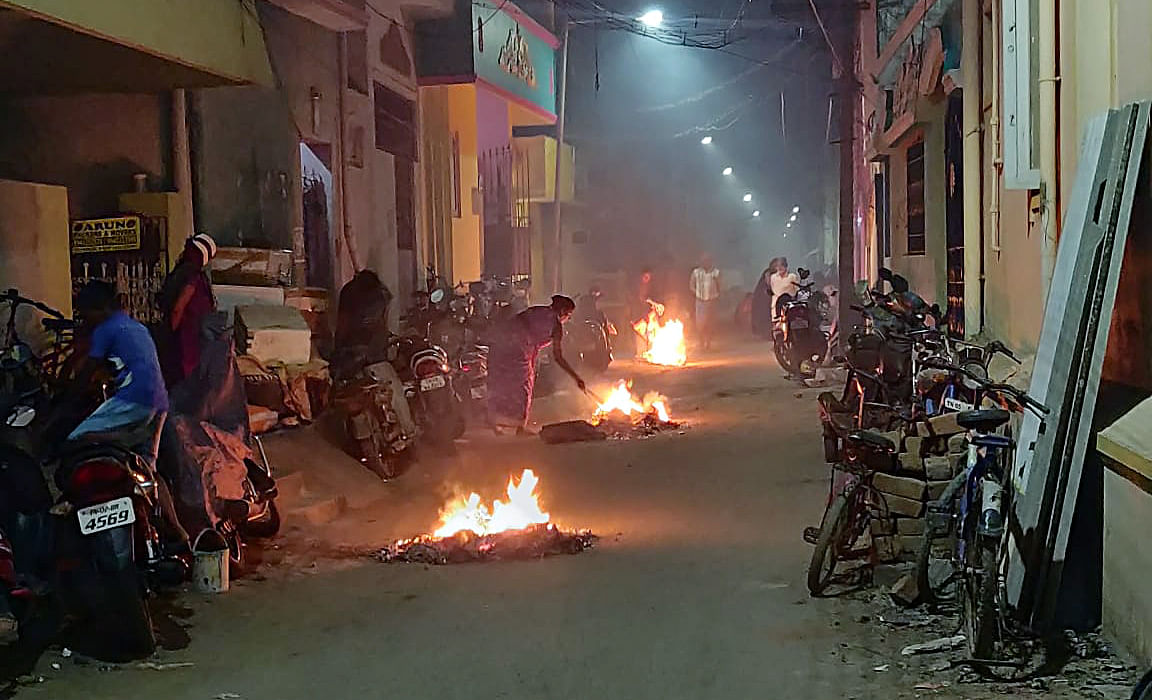 People celebrate Bhogi festival, early morning in Chennai on Tuesday. It marks beginning of the four-day Pongal festival.
