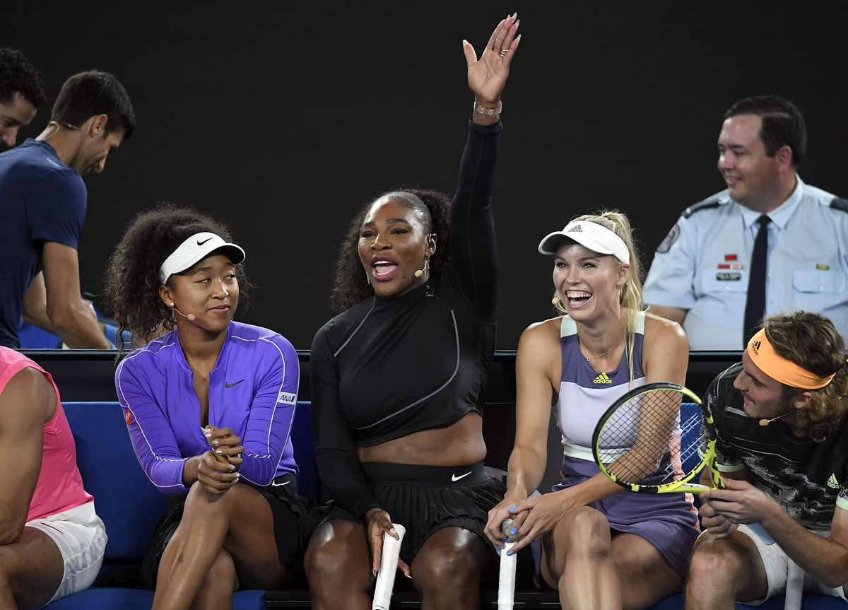 Serena Williams of the US (2/L) shares a lighter moment  with Naomi Osaka of Japan (L),  Caroline Wozniacki of Denmark (2/R) and Stefanos Tsitsipas of Greece (R) as they and other top players play in the Rally for Relief charity tennis match in support of the victims of the Australian bushfires, in Melbourne of January 15, 2020, ahead of the Australian Open tennis tournament.