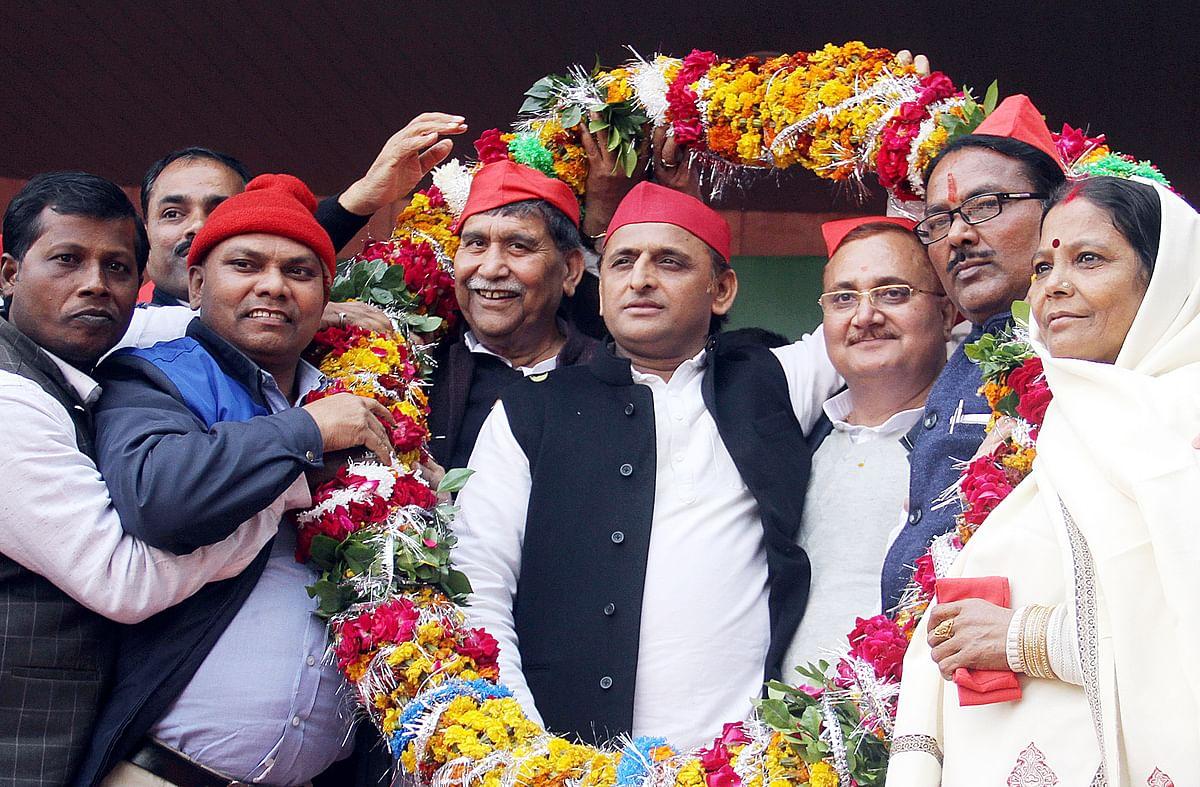 Samajwadi Party president Akhilesh Yadav with Ram Prasad Chaudhary in Lucknow.