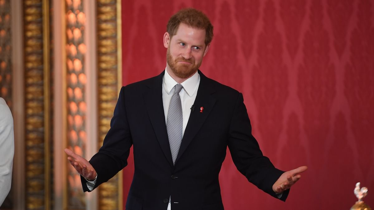 Britain's Prince Harry, Duke of Sussex gestures during the draw for the Rugby League World Cup 2021 at Buckingham Palace in London on January 16, 2019.