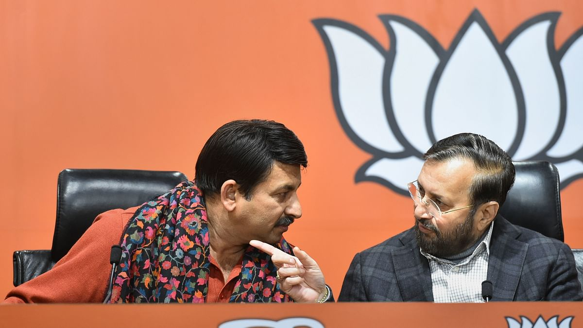 New Delhi: (L to R) Delhi BJP State President Manoj Tiwari interacts with Union Minister Prakash Javadekar during the release of BJP's  first list of 57 candidates for Delhi Assembly polls, at BJP headquarters in New Delhi, Friday, Jan. 17, 2020.