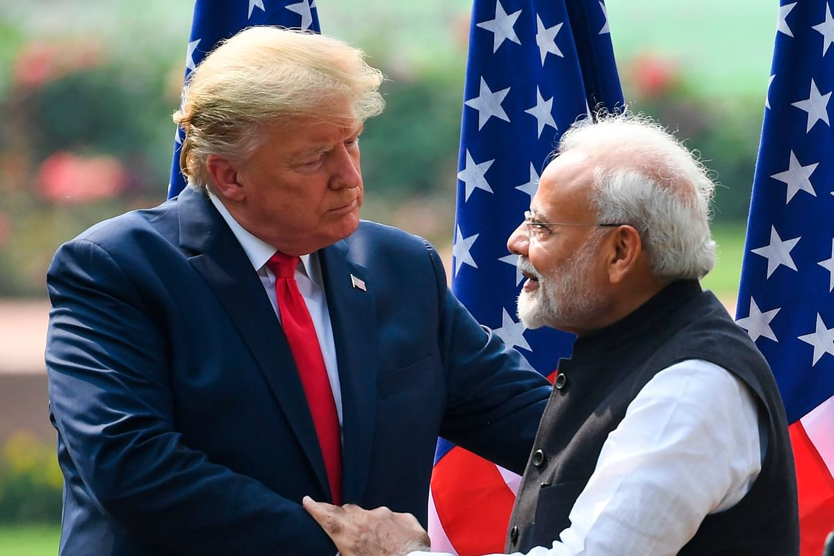 US President Donald Trump (L) shaeks hands with India's Prime Minister Narendra Modi listens during a joint press conference at Hyderabad House in New Delhi on February 25, 2020