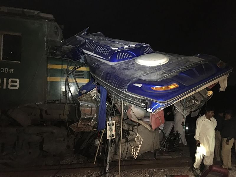 At least 20 killed as train collides with bus at an unmanned crossing in Pakistan's Sindh