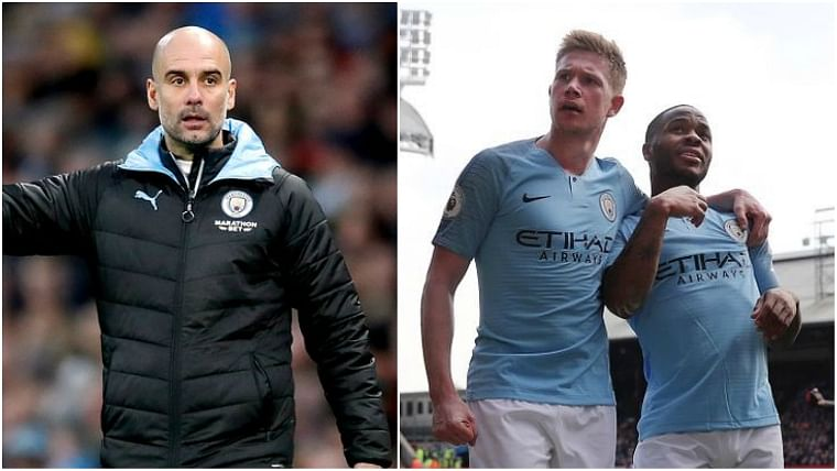 Manchester City manager Pep Guardiola and Kevin de Bruyne with Raheem Sterling