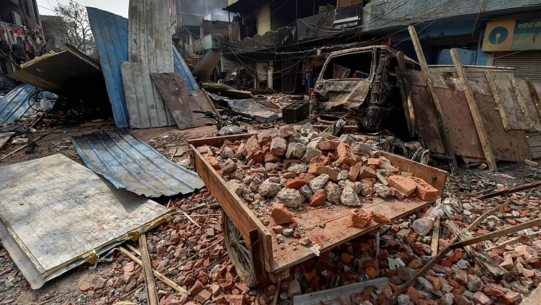 Brick-bats are seen amid vandalised properties in Bhagirathi Vihar area of the riot-affected northeast Delhi, Wednesday, Feb. 26, 2020.