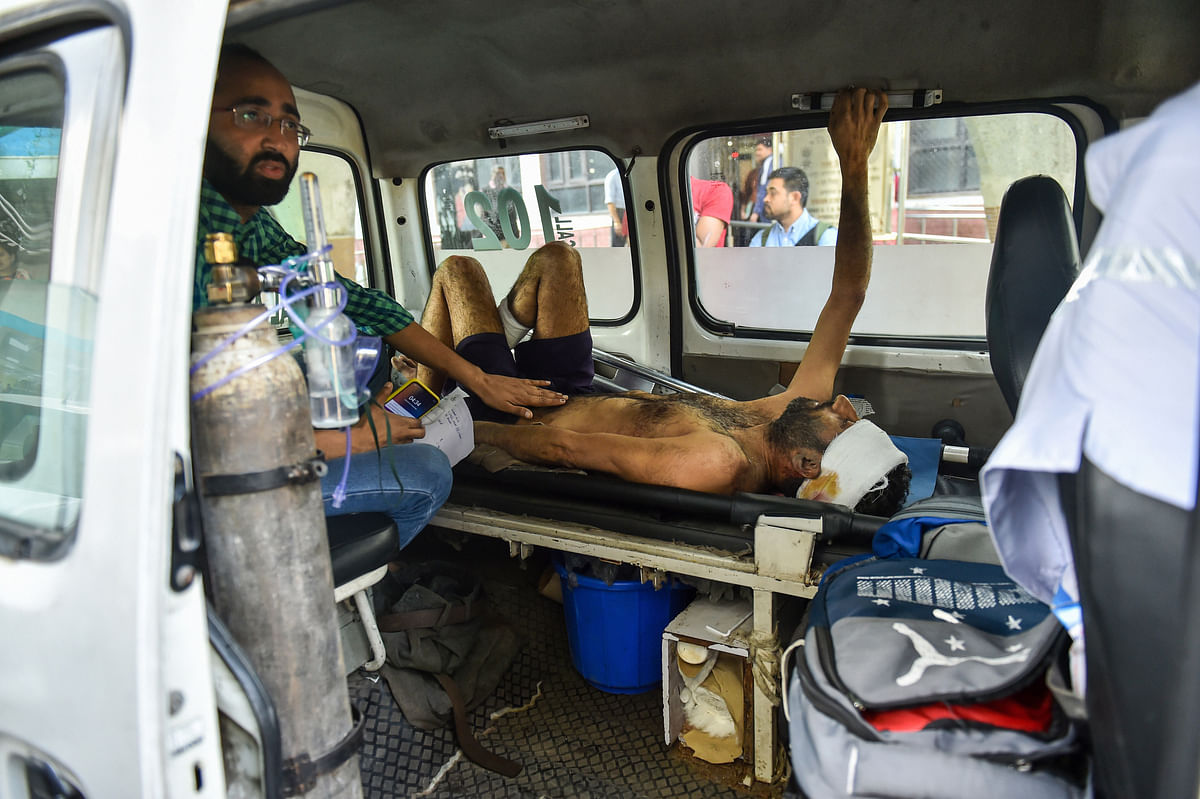 A man injured during communal violence over the amended citizenship law in the riot-affected north east Delhi, being brought to GTB hospital for treatment, in east Delhi, Wednesday, Feb. 26, 2020.