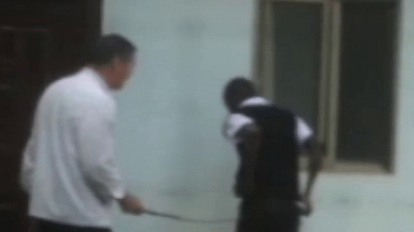Deng Haila caning a Kenyan worker for coming late at work.