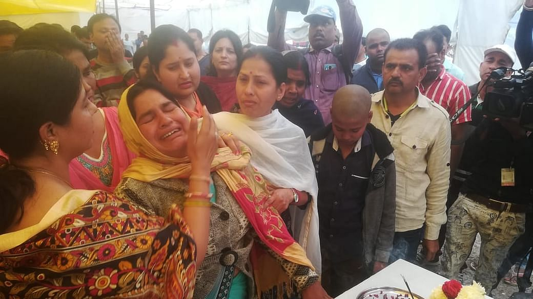 Wife of Sanjay Kumar, Lalsa Devi, becomes emotional before 'Asthi Kalash' of Sanjay at Yadgar-e-Shahjahani Park. Guest scholars pay tributes to Sanjay on Sunday. File Photo