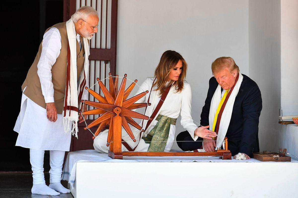 US President Donald Trump (R) US President Donald Trump, First Lady Melania Trump, with Prime Minister Narendra Modi at Sabarmati Ashram in Ahmedabad on February 24, 2020.