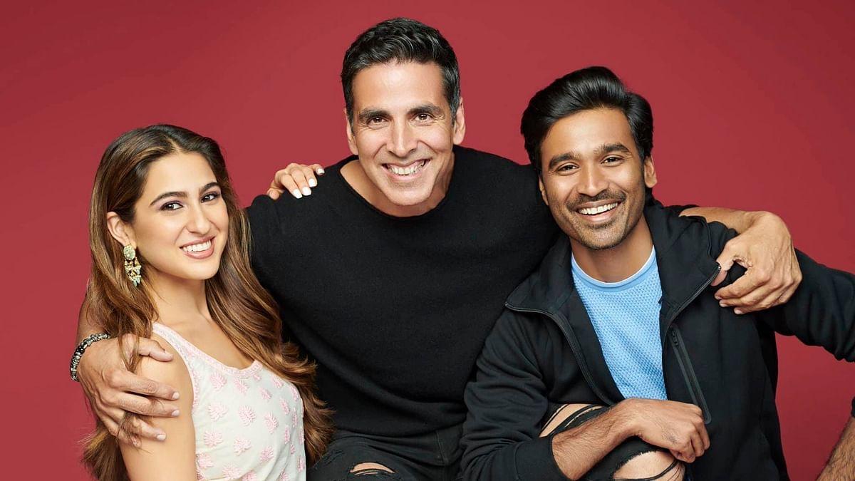 Sara Ali Khan (L) with Akshay Kumar and South Indian actor Dhanush (R)