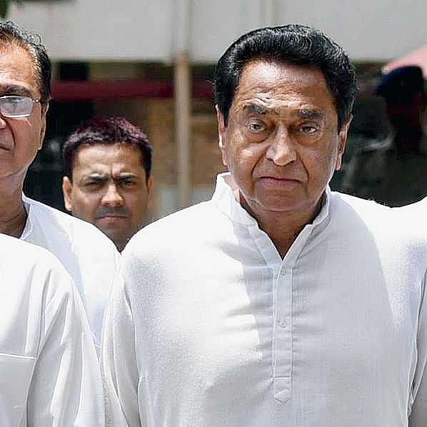 Trouble for Congress in MP: Kamal Nath rushes back to Bhopal after Scindia and MLAs go 'incommunicado'