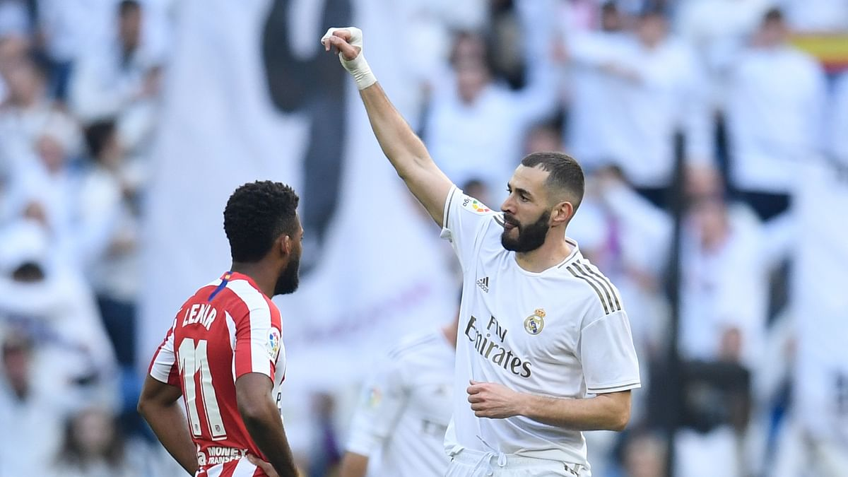 La Liga: Karim Benzema hands Real Madrid victory over Atletico in hard-fought derby