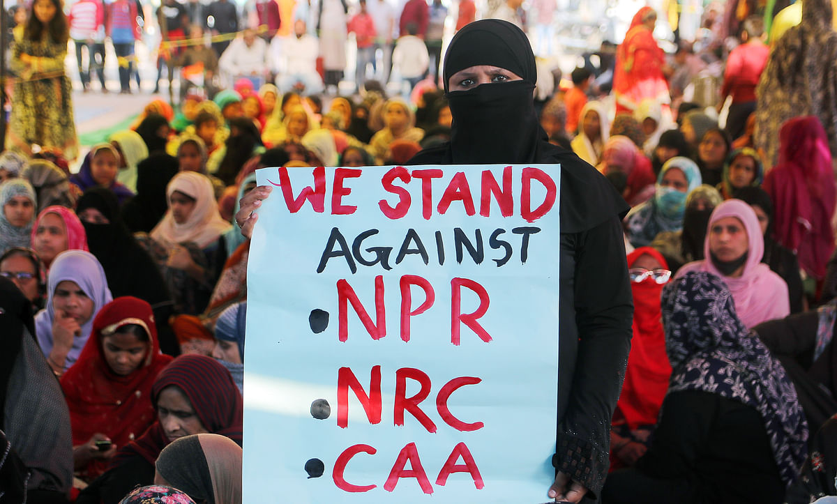 Demonstrators take part in a  protest against the Citizenship Amendment Act and NRC at Shaheen Bagh, in New Delhi on Wednesday.