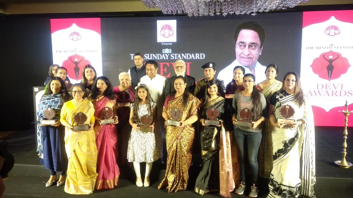 CM Kamal Nath with women recognised for their work on Friday