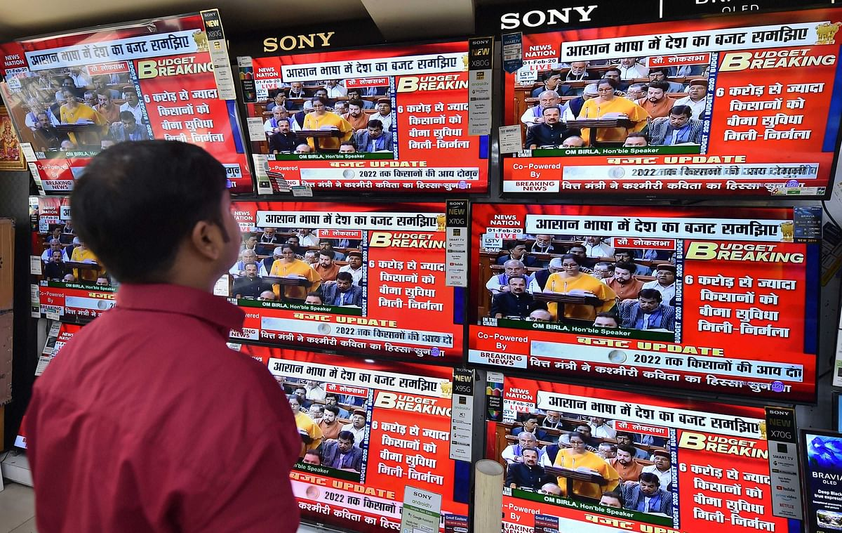 A Man watches live telecast of Union Budget 2020-21 presentation at a television showroom in Kolkata, Saturday, Feb. 1, 2020.