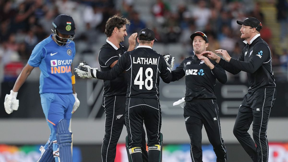 New Zealand's Colin de Grandhomme celebrates the wicket of India's wicketkeeper Lokesh Rahul for 4 runs during the second one-day international cricket match between New Zealand and India at Eden Park in Auckland on February 8, 2020.