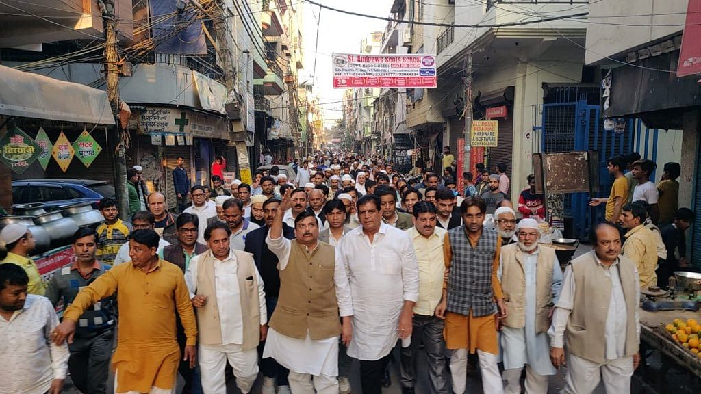 AAP leader Sanjay Singh leads a peace march in Gandhi Nagar.