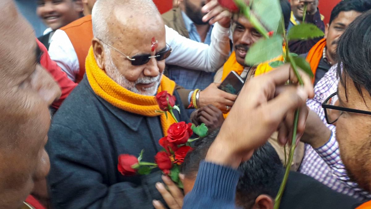 Former union minister Swami Chinmayanand being offered flowers by supporters as he walks out of prison at Shahjahanpur on Wednesday.