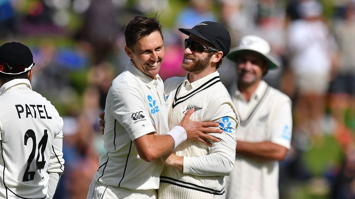 Trent Boult with capatin Kane Williamson