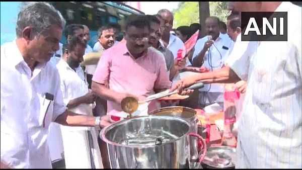 Congress workers distribute beef curry in front of police station in Kerala's Kozhikode