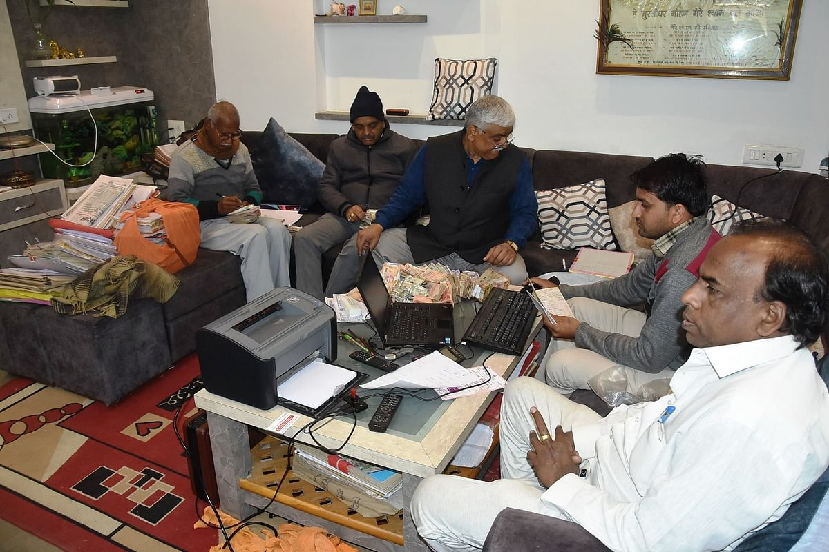 Investigating officials and Nirmal Rai(sitting at rightmost in white dress)