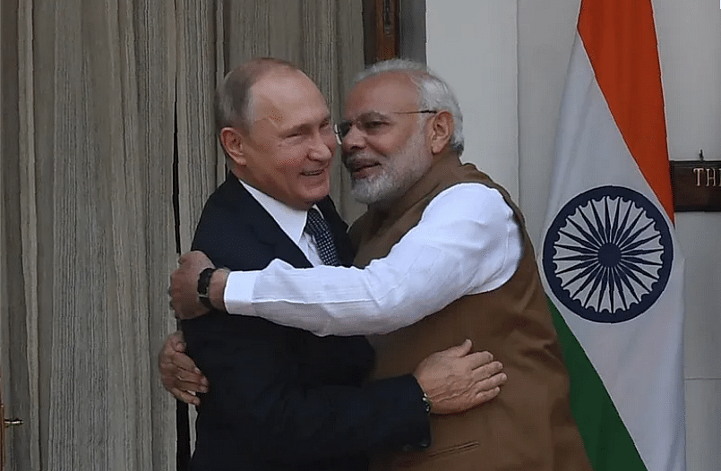 Prime Minister Narendra Modi and Russian President Vladimir Putin hug before a meeting at Hyderabad House in New Delhi on October 5, 2018